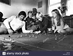 Tommy Smith plays table soccer with his wife Sue, and children ...