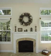 fl wreath above fireplace mantel