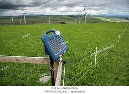Solar Powered Electric Fence Unit On Pasture With Wind Turbines In Background Adfa Newtown Powys Stock Photo Picture And Rights Managed Image Pic Fhr 90259 00028 821 Agefotostock