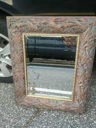 wood framed gold leaf ornamental trim