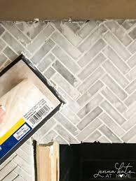 how to tile a brick fireplace jenna