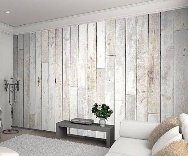 Serasikan wallpaper ruang tamu dengan furnitur.