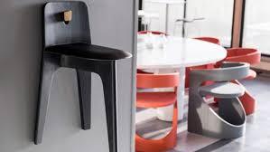 minimalist three legged stove chair
