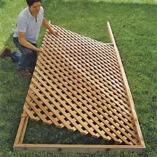 How To Build Lattice Fence Panels Set The Lattice In Place How To Build A Trellis This Old House Building A Trellis Lattice Fence Panels Backyard Privacy