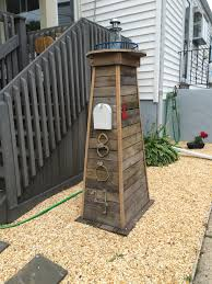 Lighthouse Mailbox We Made This For My Sister It Looks Great In Her Front Yard Lighthouse Mailbox Outdoor Decor Diy Mailbox