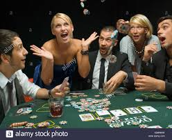 Happy woman throwing poker chips at poker game Stock Photo ...