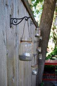 40 Creative Garden Fence Decoration Ideas Fence Decor Mason Jar Lanterns Jar Lanterns