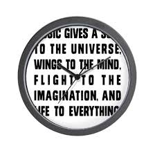 Music Gives A Soul To The Universe Wall Clock By Noisytwins Cafepress
