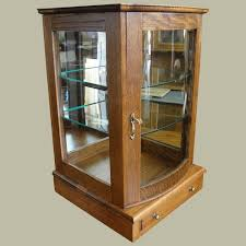 display case with curved glass door