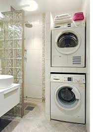 small bathroom with washer and dryer