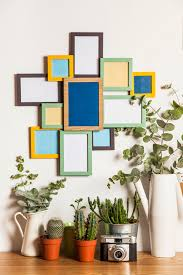 many frames on wall and plants free photo