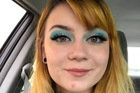heavy makeup to spite her male coworker