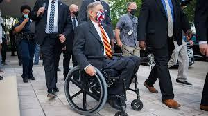 """Gov. Greg Abbott defends mask mandate to """"frustrated"""" delegates at Texas  GOP convention"""
