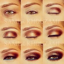bronze makeup and blue eye liner i