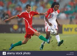 Andras Simon of Hungary (8) defends against Roy Smith of Costa Rica Stock  Photo - Alamy