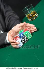 """Male player going """"all in"""" pushing his poker chips forward Stock ..."""