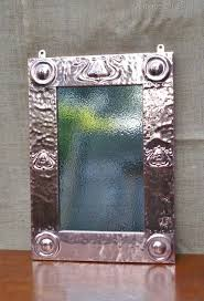 crafts mirror with stylised seed pods