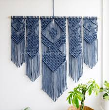 macrame wall hanging and plant hangers