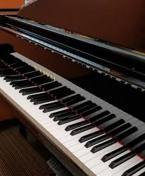 how much does a piano weigh lbs kg