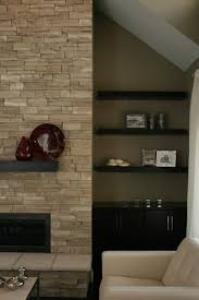 love this stacked stone fireplace with