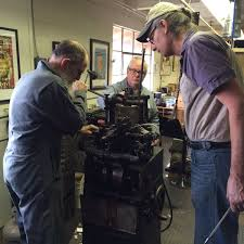 """Pinwheel Press on Twitter: """"Joe Green, Ivan Snyder, and Bill Berkuta in  conference around the Thompson caster at the CC Stern @typefoundry.  https://t.co/ZKYcPE9pSv"""""""