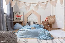 Blue Sheets On Bed And Grey Pouf In Kids Bedroom Interior With Poster And Plush Toy Real Photo Stock Photo Download Image Now Istock