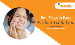 wisdom tooth pain causes symptoms