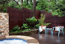 Corner Lot Fence Ideas With Contemporary Patio And Dark Stained Wood Elegant Light Blue Low Rock Wall Modern Mosaic Tile Partition Wall Patio Patio Furniture Planting Bed Private Retreat Spa Stacked Stone