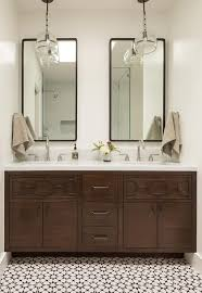 two tall black curved vanity mirrors