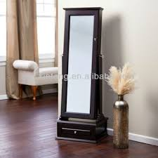 locking jewelry armoire with base drawer