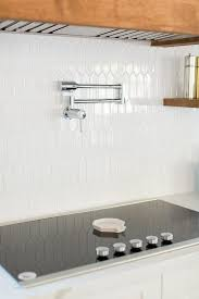 White Picket Cooktop Tiles With Swing Arm Pot Filler Transitional Kitchen