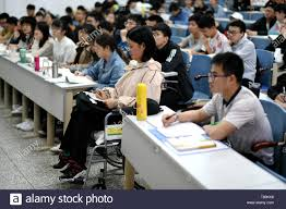 190510) -- HARBIN, May 10, 2019 (Xinhua) -- Qin Tingting (2nd R, front row) attends class