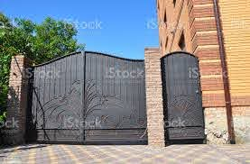 Installation Of Stone And Metal Fence With Door And Gate For Car Security Cctv Camera Is Mounted On A Brick House Wall Stock Photo Download Image Now Istock