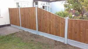 Feather Edged Fence Panels And Concrete Recessed Gravel Boards In Concrete Posts Including Sloping Panel Feather Edge Fence Panels Fence Panels Concrete Posts