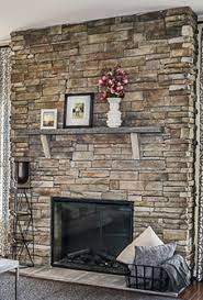 stacked stone fireplace with flush