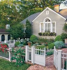 Roses Exude Charm While The Planter Under The Windows Links Garden And Architecture Cottage Front Yard Front Yard Garden Design Small Front Yard Landscaping