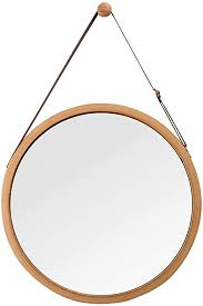 hanging round wall mirror in bathroom