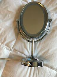double sided lighted oval mirror
