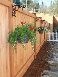 Hanging Baskets Along Fence With Images Privacy Fence Landscaping Backyard Fences Fence Landscaping