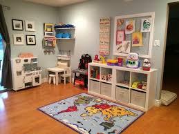 Living Room Set Up Children Welcome Nursery Play Corner For Kids Shelves Toy Resized Jpg 700 525 Kid Friendly Living Room Kids Shelves Kids Corner