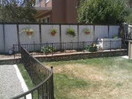 5 Design Principles For Fencing In Small Backyards With Iron Fencing
