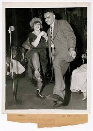 """Weegee and Edith Smith at party for """"Naked City"""" at Sammy's on the Bowery,  New York] 