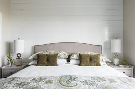 gray camelback headboard with white and