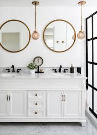 bathrooms with round vanity mirrors