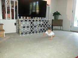 Baby Fence Around The Entertainment Center Baby Proof Entertainment Center Baby Safety Hacks Baby Proofing