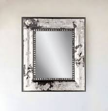 wall mirror framed in 3 traditional