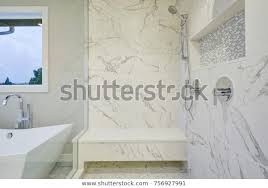 bathroom features freestanding bathtub