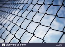Limitless Boundaries Concept Sky Through Chain Link Fence In Bokeh Background Wallpaper Stock Photo Alamy