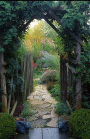 rustic garden gate covered with greens