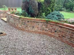 multi coloured brick front garden wall